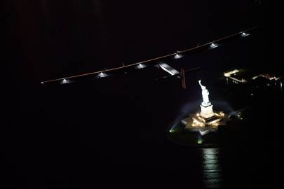 Solar Impulse 2 flies over the Statue of Liberty