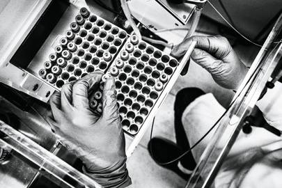 A Berg scientist places patient samples into a mass spectrometer, which converts biology into terabytes of computer data