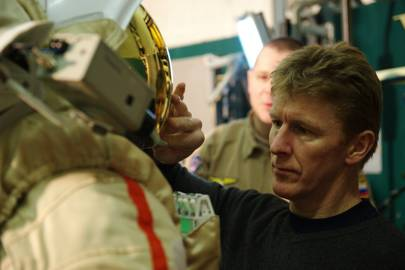 Peake inspecting a Russian Orlan suit during training at the Gagarin Cosmonaut Training Centre near Moscow