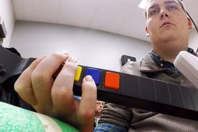 Brain implant helps paralysed man play guitar