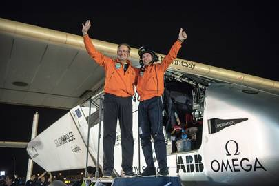 Bertrand Piccard (right) and André Borschberg, Solar Impulse's pilots, complete their round-the-world solar-powered flight in Abu Dhabi on July 26, 2016