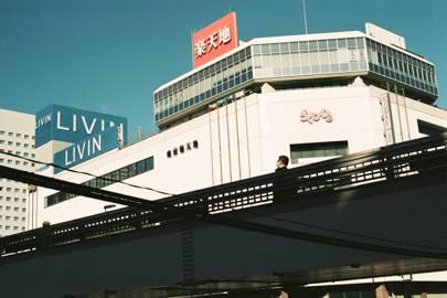 Men crossing a bridge, Tokyo