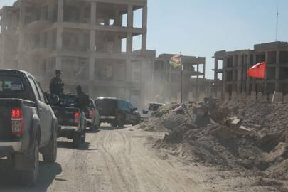 A convoy carrying commandos from the Federal Police's elite SWAT teams and officials from the Ministry of Interior passes through Fallujah's southern suburbs on the way to Shuhada 2, a neighbourhood on the front lines