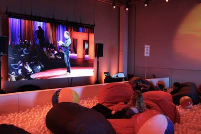 TED2016 attendees watch a live stream of the conference from a nearby ball pool