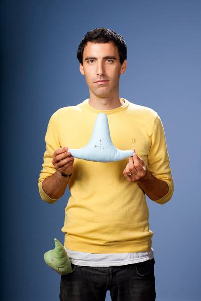 Kaggle CEO Anthony Goldbloom with a t-distribution-shaped pillow