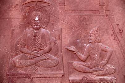 A scene from the Bhagavad Gita engraved on a Hindu temple showing a dialogue between Krishna and Arjuna