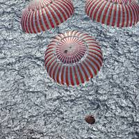 The Apollo 16 capsule descends into the Pacific Ocean