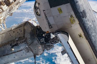 The space shuttle Discovery, seen here docked at the International Space Station in 2005