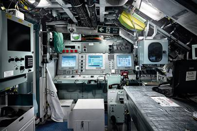 The control room, in which up to 15 crew work. The planesman steers and dives the sub from here