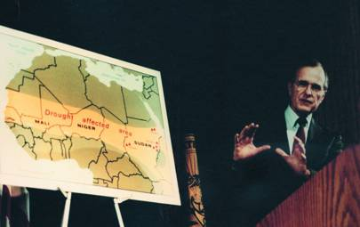 Vice President George H W Bush is pictured with a CIA map in 1985