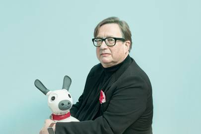Sebastian Conran with MiRo. It has 'cliff sensors' to ensure it does not fall off ledges or tables