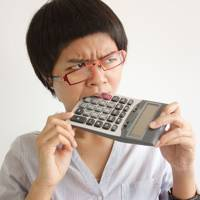 Woman eating a calculator