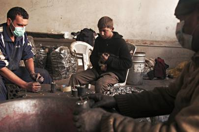 Workers assemble grenades at a makeshift factory in a rebel-held district of Aleppo