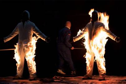 Cassils is lit on fire during their performance Inextinguishable Fire, performed on Nov 8, 2015 at the National Theatre in London as part of SPILL Festival of Performance. This piece was produced by Pacitti Company and supported by Canada Council for the Arts.