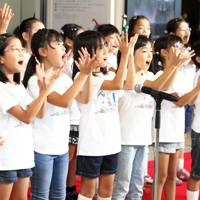 Children's chorus at Orbi's opening ceremony