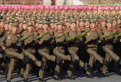 North Korean soldiers march during a mass military parade to mark the 70th anniversary of the Worker's Party of Korea on October 10, 2015