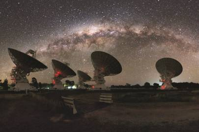 CSIRO's Compact Array in Australia under the night lights of the Milky Way