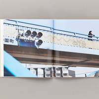 A man on a bridge in Tokyo is pictured in the book