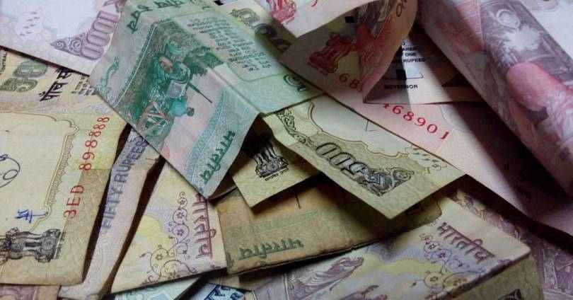 More than 600 million Indians don't have cards. So how can the country ban cash?
