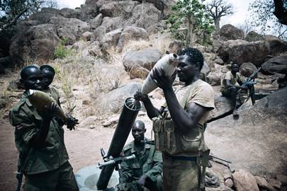 In the Jebel Kwo military base in the Nuba mountains, SPLA troops prepare a rocket attack on SFA troops in the village of Tess