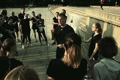 Stanley McChrystal leads a corporate group on an early morning run across Washington DC