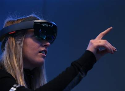 Microsoft employee Gillian Pennington demonstrates the Microsoft HoloLens augmented reality headset