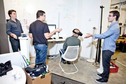 Three of Oculus' best brains (standing, from left): founder Palmer Luckey, senior vision engineer Dov Katz, and VP of product Nate Mitchell. The writer (seated) experiences some of their latest breakthroughs