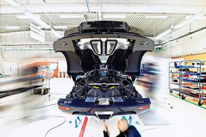 "A Koenigsegg in the company's ""Dyno room"" where the electronics, gearbox and engine are tested before the body panels are attached. It takes eight months for each model to make it through the seven assembly stations to completion"