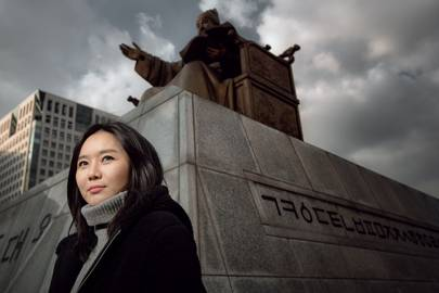 Hyeonseo Lee in front of the King Sejong Statue in Gwanghawmun Square, Seoul. Hyeonseo saw her first public execution at the age of seven. She escaped North Korea alone as a teenager and now works around the world as an activist