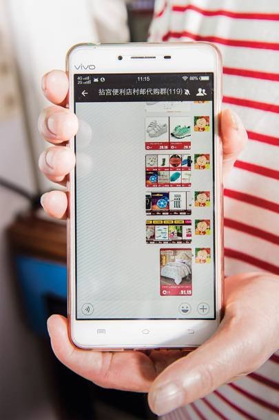 Qui Sai Zhen shows products to her customers on her smartphone via a [i]WeChat [/i]group featuring 115 people