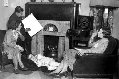 A family listening to the radio in Britian in 1931. Radio mentions in the newspaper peaked during the war years