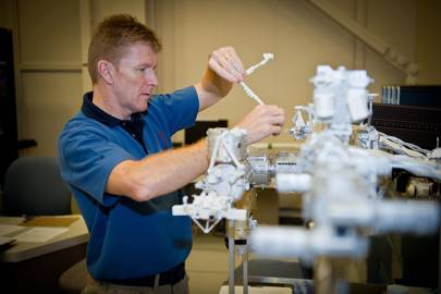 "ESA astronaut Timothy Peake training at the Canadian Space Agency headquarters on the robotic ""Canadarm"" for his mission on the International Space Station."