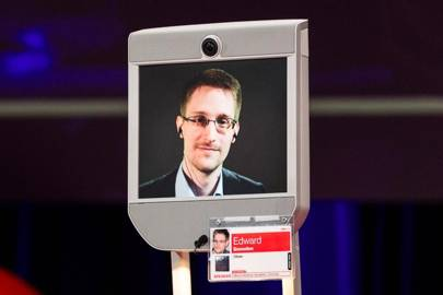 Snowden: Big revelations to come, reporting them is not a crime