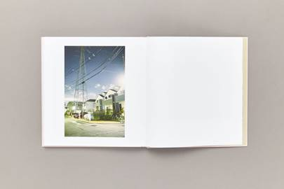 Suburban streets shadowed by huge pylons in Tokyo from Good Luck & Do Your Best