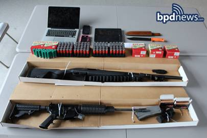 Police found a 12-gauge Remington shotgun, an AR-15 rifle, several hundred rounds of ammunition and a hunting knife