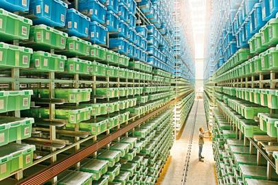 Boxes of Lego are stacked 23 metres high in one of four storage rooms, holding around a billion bricks in total. Robotic cranes fetch decoration or packaging parts.