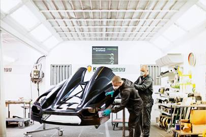 The paint station is the third of seven stages through which the care passes. Koenigsegg lays down a 150-micron clear coat (three times the depth of the clear coat sprayed on an average car) on top of the pain to resist chips and scratches. Achieving a perfectly smooth surface takes seven coats