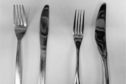 The lightweight cutlery (left) weighed three times less than the heavier cutlery (right)