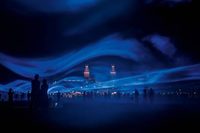 Visitors watch Roosegaarde's immersive show, [i]Waterlicht[/i], during its exhibition in Amsterdam's Museumplein museum quarter