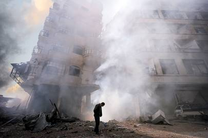 The aftermath of a Syrian Air Force attack on the Damascus suburb of Ain Tarma in January 2013