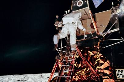 Neil Armstrong descends onto the Moon